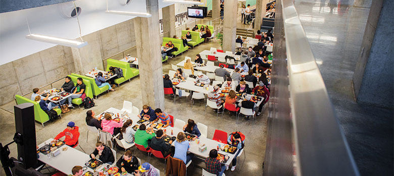 View from above of students eating in Ernie Davis Dining Center