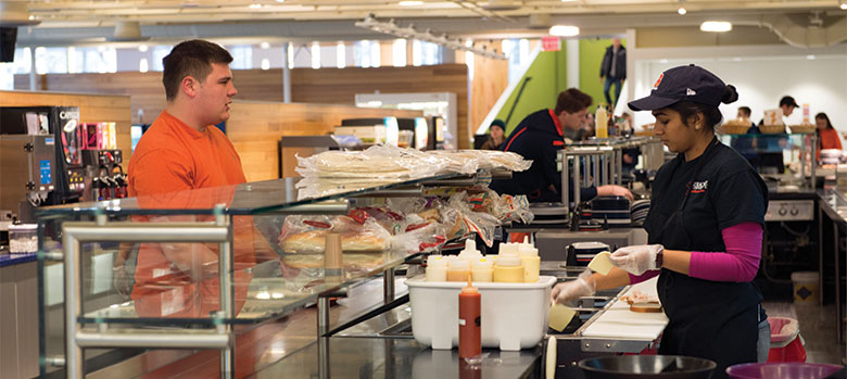 Student ordering a sandwich in Sadler Dining