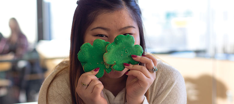 Student with shamrock shaped cookies